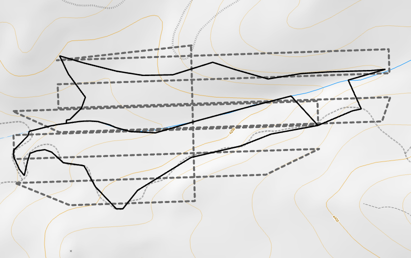 The flight plan criss-crosses horizontally across the sloped project area